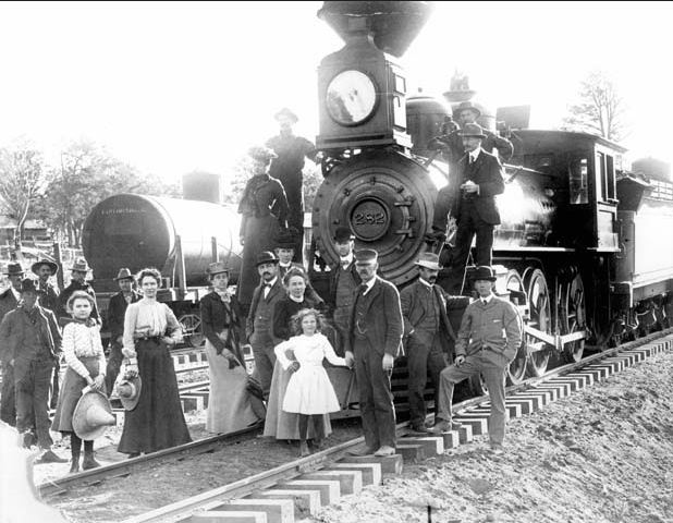 First train to carry passengers all the way from Williams, AZ to Grand Canyon Village. Group posing in front of locomotive. 17 sep 1901.