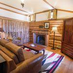 Log-walled bedroom inside the Buckey O'Neill Suite