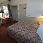 Double bed and light green panelling in the Bright Angel Lodge