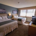 Tranquil, contemporary two bed guest room at the Thunderbird Lodge