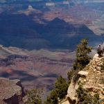 A dark shadow sweeps across the Grand Canyon.
